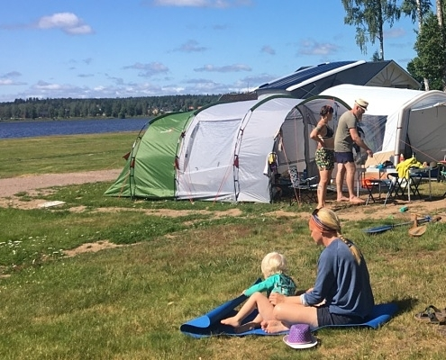 Tents and children on camping site
